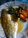 Baked haddock with citrus sauce and roasted broccoli and carrots