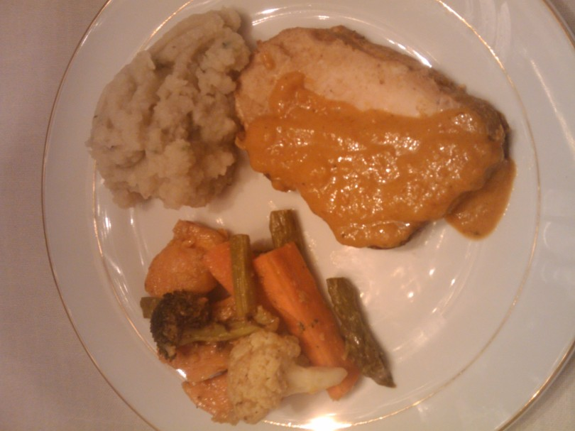 Roasted pork with roasted red pepper sauce, apple pear celery root puree, and roasted vegetables
